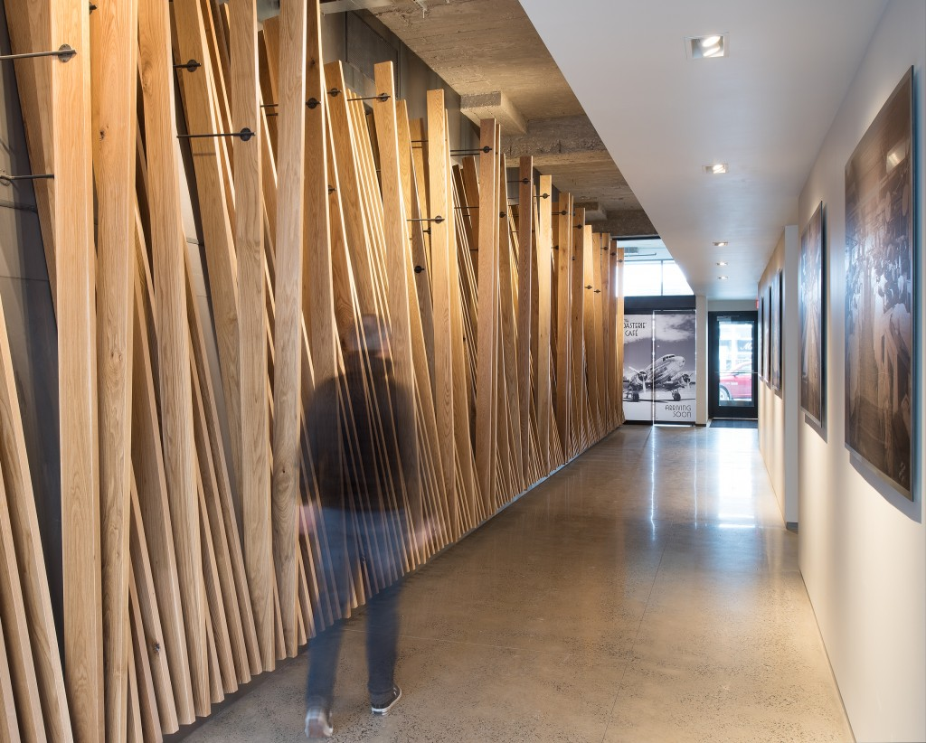 Custom Wood Wall at Corrigan Station, Kansas City, MO. Architectural Photography by Randy Braley Photography.